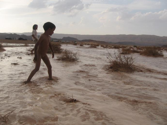 children run into the flood